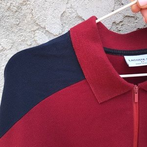 A burgundy navy and white Lacoste polo shirt